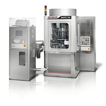 Riempitrice capsula / multicontenitori / interamente automatica / semiautomatica