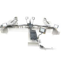 Sistema di carico e scarico per l'industria farmaceutica