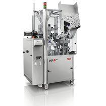 Riempitrice-sigillatrice automatica / rotativa / per prodotti farmaceutici / per tubi