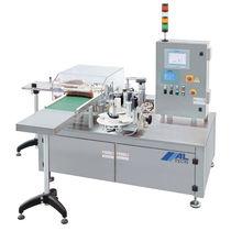 Etichettatrice automatica / per aplicazioni sulla parte superiore del prodotto / di bottiglie / per l'industria farmaceutica