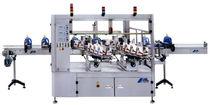 Etichettatrice automatica / per applicazione laterale / per prodotto cilindrico / compatta