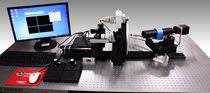 Apparecchio per prove ottico / controllato da computer / automatico