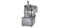 Riempitrice di bottiglie / semiautomatica / lineare / di liquido