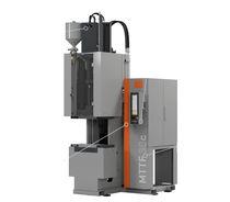 Pressa ad iniezione verticale / idraulica / per gomma