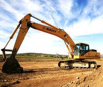 Escavatore intermedio / cingolato / per cantiere / per miniere e cave