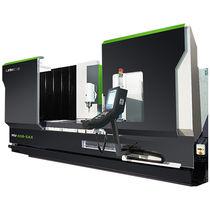 Centro di lavoro CNC 5 assi / verticale / a montante mobile / a tavola rotante