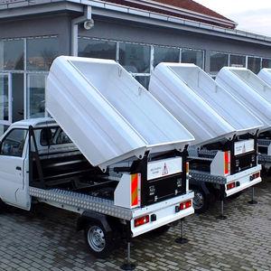veicolo raccolta rifiuti con caricamento dall'alto