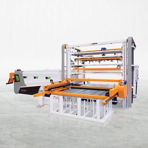sistema di carico e scarico per taglio