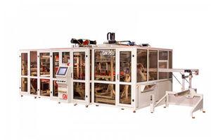 macchina per termoformatura, taglio e impilaggio alimentata a rullo / per imballaggi / automatizzata