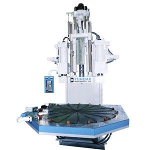 pressa ad iniezione verticale / idraulica / elettrica ed idraulica / per PVC