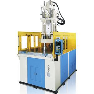 pressa ad iniezione verticale / idraulica / ibrida / per PVC
