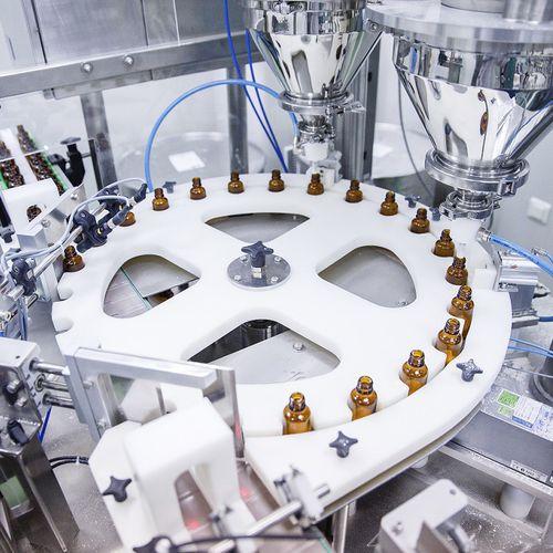 riempitrice tappatrice monoblocco / rotativa / ponderale / per prodotti farmaceutici