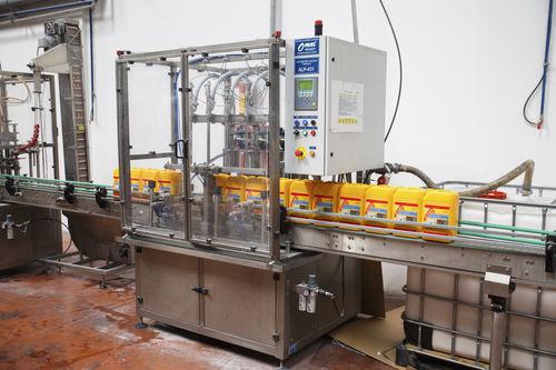 linea di riempimento di bottiglie / automatica / lineare / volumetrica
