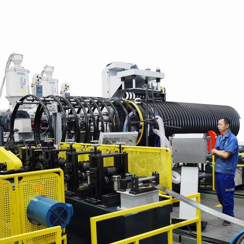 linea di estrusione per tubi scanalati / per tubi / per compositi acciaio-polimero / per guaine corrugate con tubi incorporati